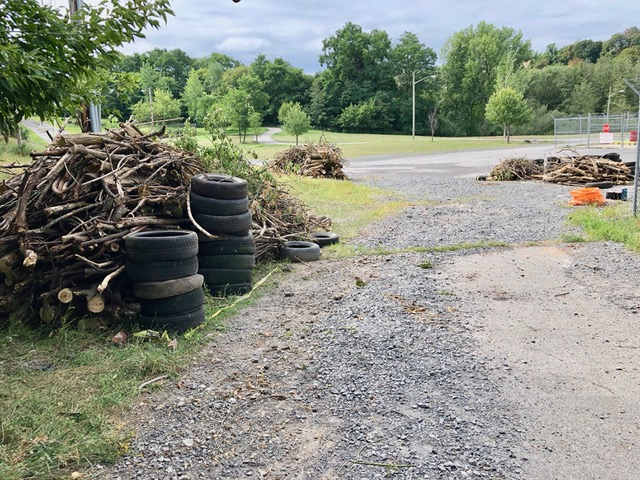 The piles of debris on RG&E property removed from the Brewer Street perimeter of #1179 St. Paul Street generated by the August 24th and 25th Brockport College and University of Rochester Incoming freshmen community service project on behalf of REACH Advocacy.