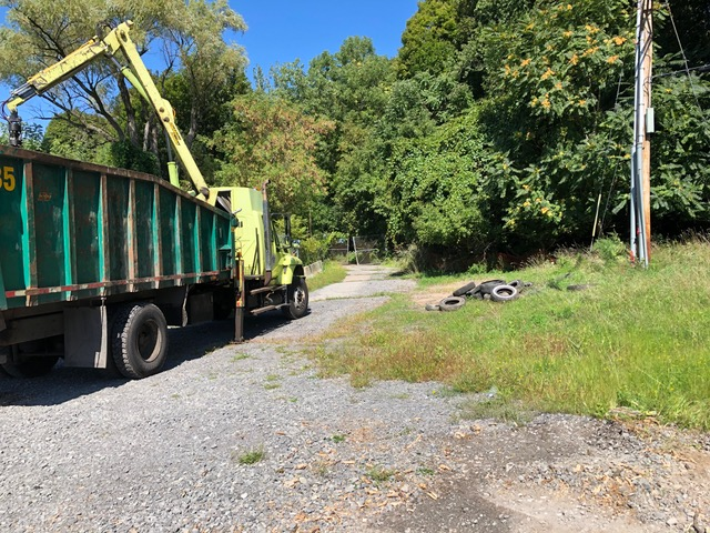 All wood removed from a second pile. The City later picked up the sixty-plus tires with a separate vehicle. The Brewer Street extension access is cleared for vehicle use along its entire length.