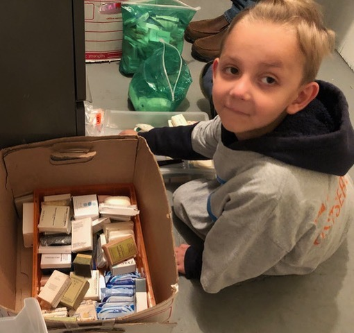Re-stocking the bars of soap that were sorted by LDS helpers last spring at REACH Home.