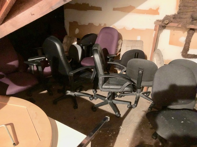 Office chairs dating back to building's former use as a rectory and as a day care center.