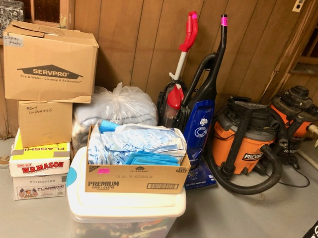 REACH supplies brought to new shelter.