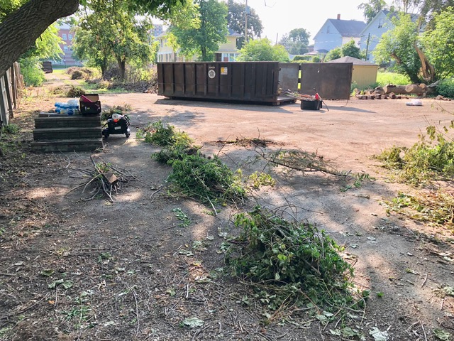 Before the Brockport Saturday of Service arrival. One dumpster was located near St. Paul street entrance and one seen here at the rear paved surface. Note the debris piles along the entire driveway.