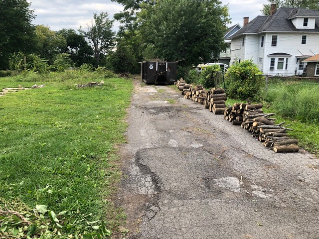 Two dumpsters were completely full at the end of the day. Will ensure that loads settle below top of dumpsters before pick-up on Tuesday. Remaining piles will be arranged neatly and compactly along tree lawn.