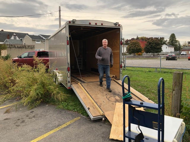 Loading appliances at 102 North Union (REACH Home at Dimitri House). Ominous rain clouds filled the skies all morning.