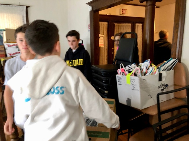 Loading the poly bagged & boxed items that were packed by fellow McQuaid students last spring.