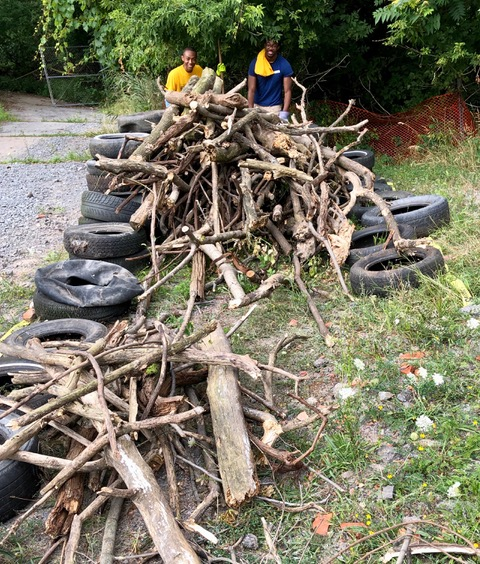 Pile #1:Sorting by size will save dumpster space. Tires keep pile tight and compact until pick-up. Still have Monday's service day ahead with the University of Rochester Wilson Day freshmen.