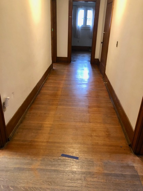 North hallway on second floor; the area below blue tape not yet done.
