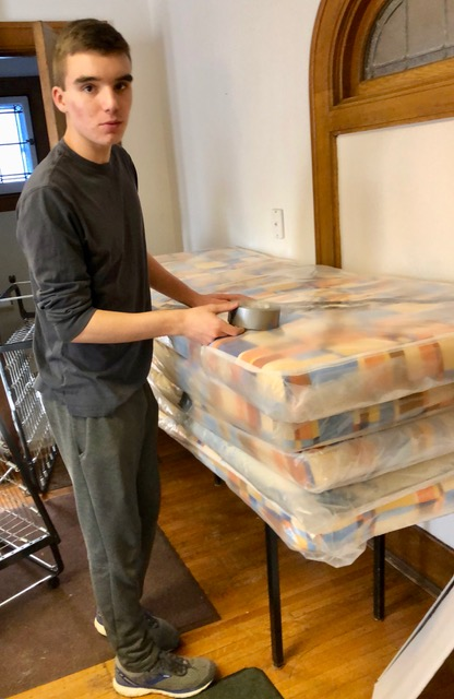 Ben sealing poly mattress protectors.