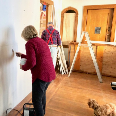 Everybody needs a good supervisor. Brit barks directions. This room was originally the rectory dining room with pantry door visible.
