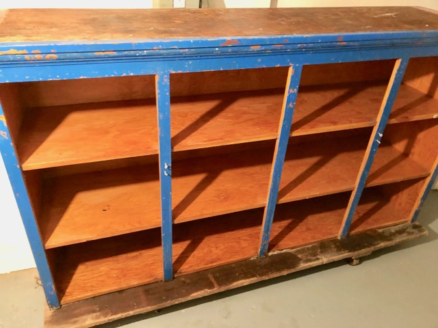 Former day care center shelving units repurposed for storing guests' possessions when they arrive.
