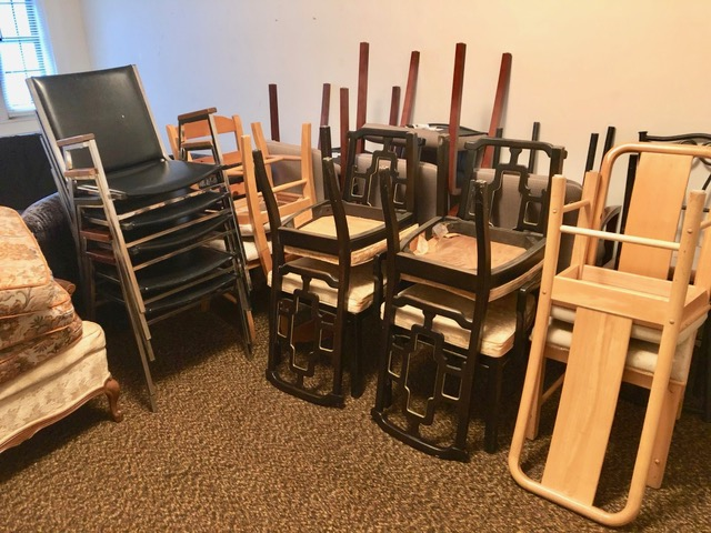 Furniture belonging to church group moved to dry storage on third floor.