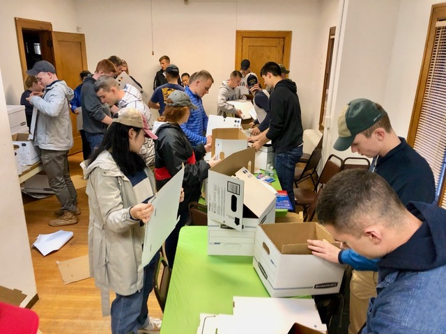 """Folding boxes that will contain a """"welcome kit"""" of hygiene supplies, some new clothing and a towel  for shelter residents."""
