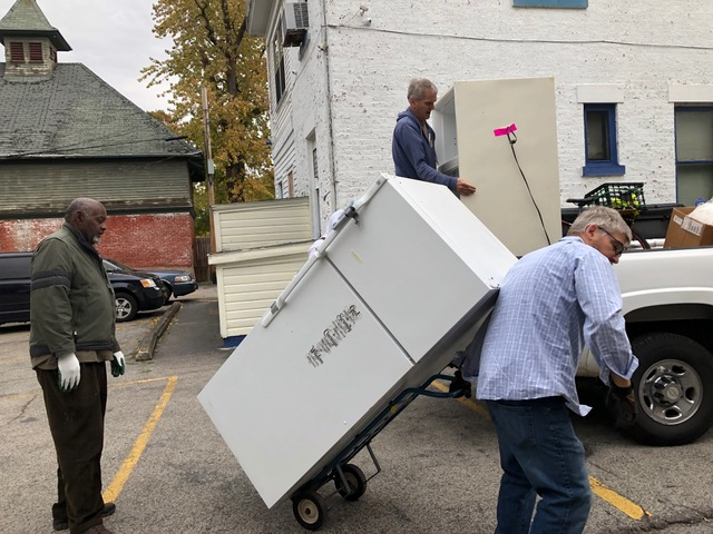 House of Mercy staff bring additional materials from last year's wintertime shelter  to the new location at 720 West Main.