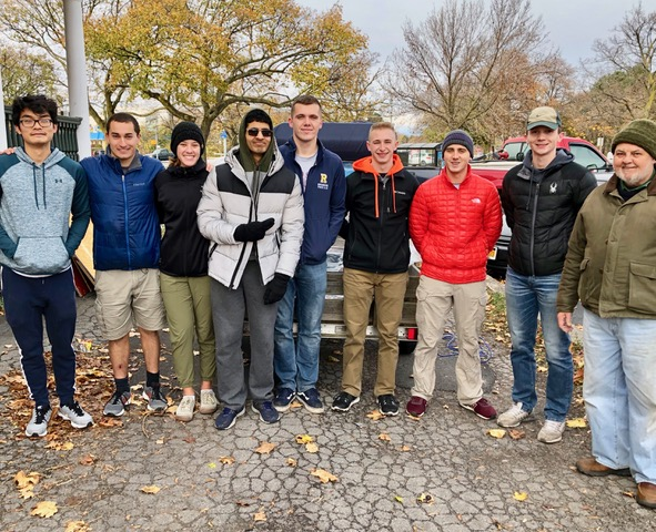 NROTC helpers 11/9/19 with REACH Co-chair Peter Peters